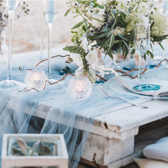 blue table setting with flowers