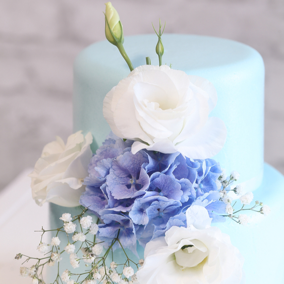 blue wedding cake with flowers