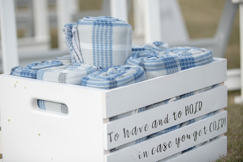 Crate With Blankets For Wedding Guests
